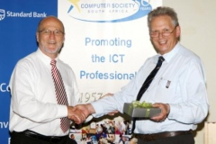 Derek Hanekom receiving gift from Peter Waker