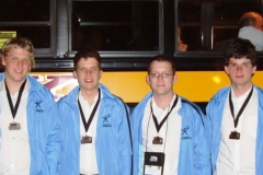 2010-ioi-team-with-medals-at-bus