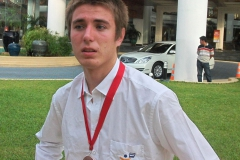 Bennie Swart with medal in front of Hotel